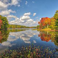 New England fall foliage peak colors at Brigham Pond in Hubbardston, Central Massachusetts. <br /> <br /> Massachusetts Brigham Pond peak fall foliage photos are available as museum quality photo, canvas, acrylic, wood or metal prints. Wall art prints may be framed and matted to the individual liking and interior design decoration needs:<br /> <br /> https://juergen-roth.pixels.com/featured/brigham-pond-in-hubbardston-massachusetts-juergen-roth.html<br /> <br /> Good light and happy photo making!<br /> <br /> My best,<br /> <br /> Juergen