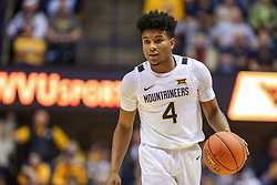 Dec 1, 2019; Morgantown, WV, USA; West Virginia Mountaineers guard Miles McBride (4) dribbles during the second half against the Rhode Island Rams at WVU Coliseum. Mandatory Credit: Ben Queen-USA TODAY Sports