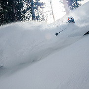 Tanner Flanagan skis spring powder in the backcountry near Jackson Hole Mountain Resort.