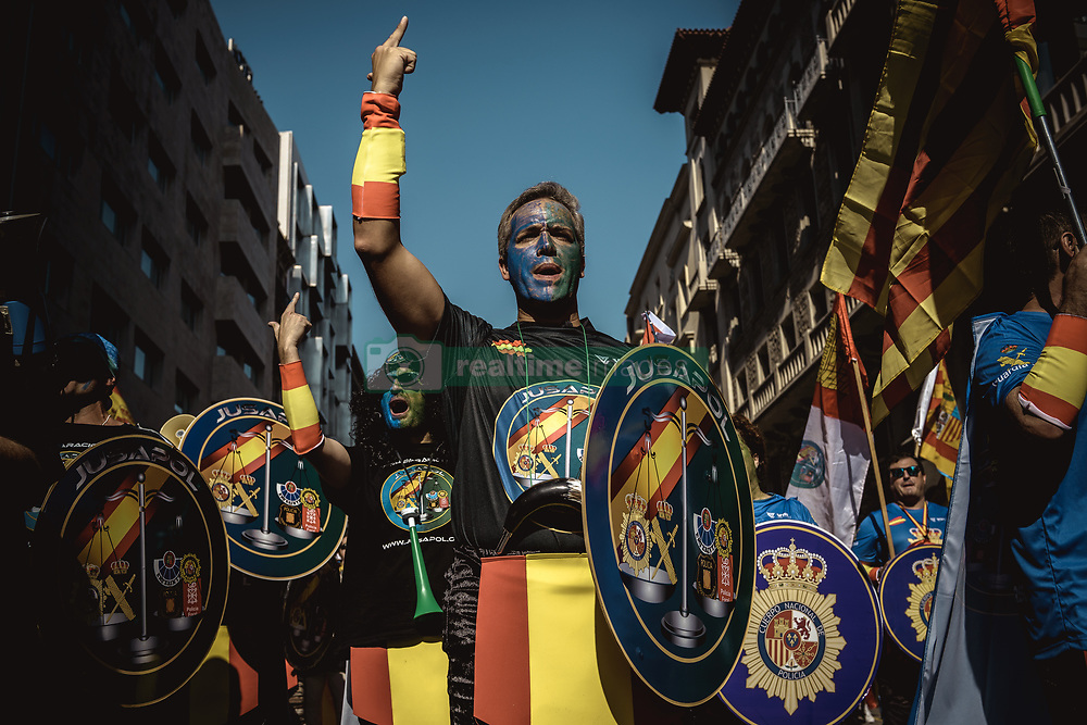 September 29, 2018 - Catalonia, Spain - Police officers of the National Police and Civil Guard shout slogans as they march through Barcelona to pay homage to the participants of last years 'operacion copernico', a massive police deployment within the Catalan secession referendum at October 1st, and to protest for a salary equality with the regional police forces (Credit Image: © Matthias OesterleZUMA Wire)