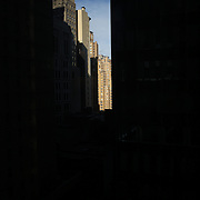 A street scene showing light catching high rise buildings of  Manhattan, New York, USA.  Photo Tim Clayton
