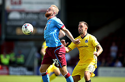 Kevin van Veen of Scunthorpe United chests the ball ahead of Peter Hartley of Bristol Rovers  - Mandatory by-line: Matt McNulty/JMP - 06/08/2016 - FOOTBALL - Glanford Park - Scunthorpe, England - Scunthorpe United v Bristol Rovers - Sky Bet League One
