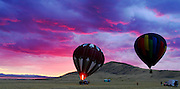 Storm clouds glow from the setting sun as balloonists make a last second attempt to go aloft following a storm at Antelope Island State Park in Utah. Colin Braley