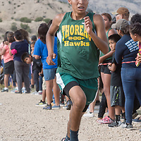 Thoreau High School senior Dallen Plummer sprints for a first place finish at the Tohatchi Invitational Cross Country Meet at Hamburger Hill in Tohatchi, NM.