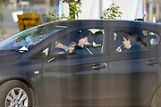 NHS (National Health Service) workers or care worker family are seen taking nasal swabs at o2 testing Centre for COVID-19 at a drive-through testing centre in a car park at O2 Testing centre in Greenwich, London, Monday, May 4, 2020. <br /> The UK continues in lockdown to help curb the spread of the coronavirus, which has impacted on nations around the globe imposing self-isolation and exercising social distancing when people move from their homes. (Photo/ Vudi Xhymshiti)