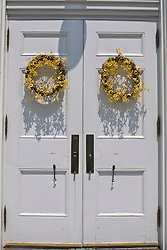 white church doors and wreaths on Shelter island, NY