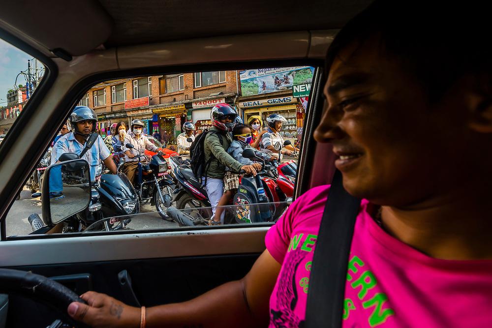 Busy street full of motorycle traffic, Kathmandu, Nepal.