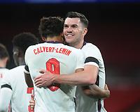 Football - 2019 / 2020 season - International Friendly - England vs Wales - Wembley Stadium.<br /> <br /> Michael Keane of England  celebrates with goalscorer, Dominic Calvert - Lewin<br /> <br /> COLORSPORT/ANDREW COWIE