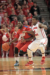 07 December 2013:  Khari Price brings the ball up the court guarded by Bobby Hunter  during an NCAA mens basketball game. The Illinois State Redbirds beat the 25th ranked Dayton Flyers 81-75 in Redbird Arena, Normal IL