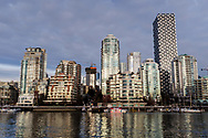 Sunset illuminates condominiums along the waterfront of Yorktown in Vancouver, British Columbia