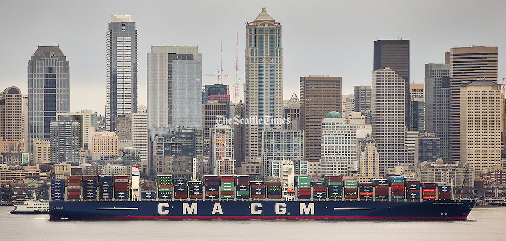 The CMA CGM Benjamin Franklin,<br /> the largest cargo ship to visit the United States, along the Seattle waterfront. The Benjamin Franklin is more than 1,300 feet long, 177 feet wide and has a draft of 52 feet. <br /> <br /> Mike Siegel / The Seattle Times