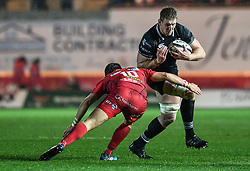 Ospreys' Bradley Davies is tackled by Scarlets' Dan Jones - Mandatory by-line: Craig Thomas/Replay images - 26/12/2017 - RUGBY - Parc y Scarlets - Llanelli, Wales - Scarlets v Ospreys - Guinness Pro 14