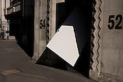 Workman delivering plaster wallboard destined for inside central London office building.