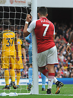 Football - 2017 / 2018 Premier League - Arsenal vs. Brighton & Hove Albion<br /> <br /> Alexis Sanchez of Arsenal takes a rest against the post at The Emirates.<br /> <br /> COLORSPORT/ANDREW COWIE