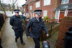 © London News Pictures. 26/02/2015. Police patrol past Flat 2 Leeve House, 20 Lancefield streetin West London, believed to be a current or former address of ISIS terrorist Jihadi John. Photo credit: Ben Cawthra/LNP