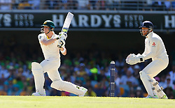Australia's Steve Smith r plays a shot during day two of the Ashes Test match at The Gabba, Brisbane.