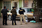 Juarez Police investigate a multiple shooting in a slum in Juarez, Mexico January 15, 2009 after a drug related shooting killed four people. The shooting, believed linked to the ongoing drug war which has already claimed more than 40 people since the start of  the year. More than 1600 people were killed in Juarez in 2008, making Juarez the most violent city in Mexico.    (Photo by Richard Ellis)