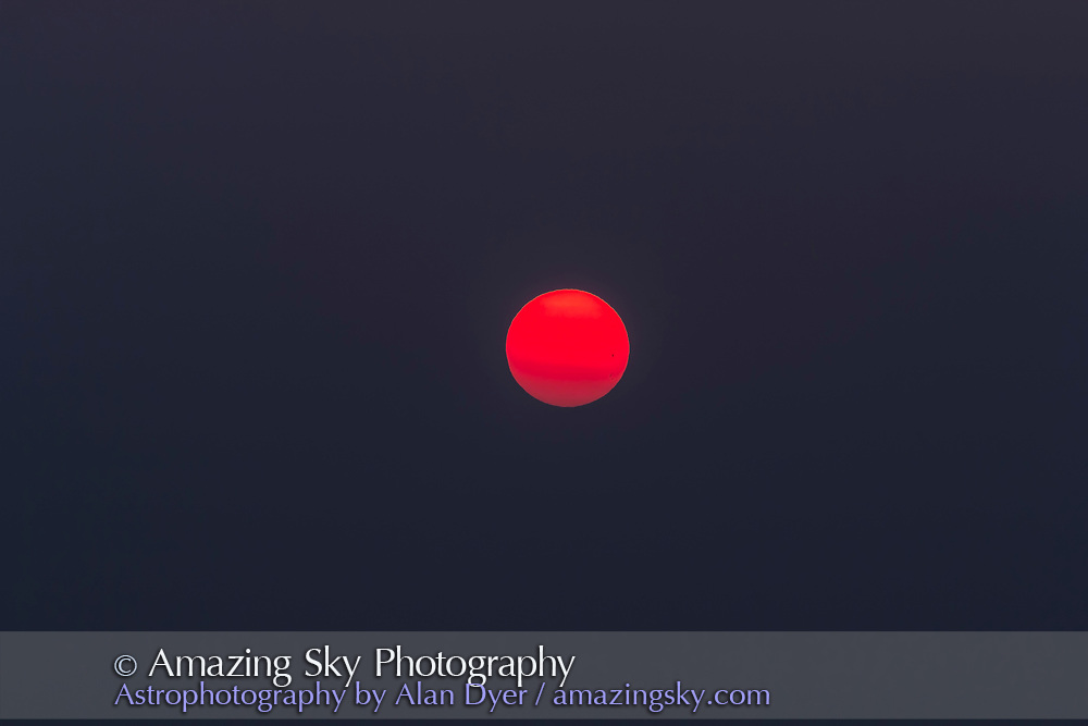 Two groups of sunspots just visible to the naked eye but here dimmed by smoke at sunset on September 7, 2017. <br /> <br /> Taken with the Canon 60Da and 200mm lens and 1.4x extender to simulate a binocular field of view.