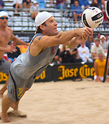 Dig Magazine - Professional beach volleyball John Hyden passes a tough serve at The 2011 US Open Hermosa Beach Championships.<br /> September 25th, 2011<br /> Copyright 2011 Don Liebig/Dig Magazine