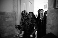 Rabia is being taken to the operating theatre to get her baby delivered by a caesarean section. In rural areas surgery is rare and most people can't afford the expensive treatments in private hospitals. Thari Mirwah, Pakistan, 2010