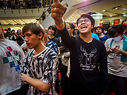 "25 JANUARY 2019 - BANGKOK, THAILAND: Young men react to women Japanese performers during a ""J Pop"" (Japanese Pop music) concert at the Japan Expo in Central World, a shopping mall in Bangkok.      PHOTO BY JACK KURTZ"