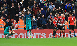 Tottenham Hotspur's Davinson Sanchez (second left) looks dejected as Southampton players celebrate