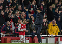 Football - 2019 / 2020 Premier League - Arsenal vs. Everton<br /> <br /> Mikel Arteta, Manager of Arsenal FC, and Dani Ceballos (Arsenal FC) celebrate as the final whistle blows at The Emirates Stadium.<br /> <br /> COLORSPORT/DANIEL BEARHAM