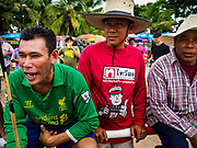 04 OCTOBER 2017 - CHONBURI, CHONBURI, THAILAND: Jockeys watch the water buffalo races. Contestants race water buffalo about 100 meters down a muddy straight away. The buffalo races in Chonburi first took place in 1912 for Thai King Rama VI. Now the races have evolved into a festival that marks the end of Buddhist Lent and is held on the first full moon of the 11th lunar month (either October or November). Thousands of people come to Chonburi, about 90 minutes from Bangkok, for the races and carnival midway.   PHOTO BY JACK KURTZ