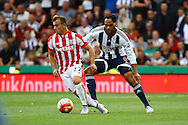 Xherdan Shaqiri of Stoke City gets away from Joleon Lescott of West Bromwich Albion. Barclays Premier League match, Stoke city v West Bromwich Albion at the Britannia stadium in Stoke on Trent, Staffs on Saturday 29th August 2015.<br /> pic by Chris Stading, Andrew Orchard sports photography.