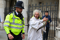 © Licensed to London News Pictures. 15/07/2019. London, UK. A police officer speaks with a protester. <br /> Hundreds of Extinction Rebellion climate change activists protests outside the Royal Courts of Justice demanding the legal system take responsibility in the climate change crisis, and ensure the safety of future generations by making ecocide law. The environmental group is staging similar protests in  Leeds, Cardiff, Glasgow, Bristol, Norwich and other cities around the country. Photo credit: Dinendra Haria/LNP