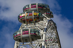 "© Licensed to London News Pictures. 06/03/2020. London, UK. A piece of street art ""LONDON"" by Ben Eine wraps a pod on London's ferris wheel - The London Eye marks its 20th anniversary next week. Photo credit: Dinendra Haria/LNP"