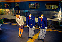 Train conductors bowing to arriving passengers (Saemaul Express Train, Pusan Train Station, Pusan (Busan), South Korea