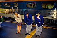 Train conductors bowing to arriving passengers (Saemaul Express Train, Pusan Train Station, Pusan (Busan), South Korea