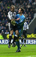 Photo. Glyn Thomas.<br /> Newcastle United v Aston Villa. Barclaycard Premiership.<br /> St James' Park, Newcastle. 01/11/03.<br /> The referee points to the penalty spot in the second half, but Alan Shearer (L) tussles with Villa keeper Thomas Sorensen - just minutes later Sorensen saved Shearer's penalty attempt.