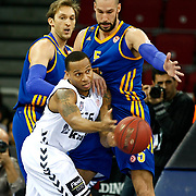 Besiktas's Curtis Jerrells and BC Khimki MR's James Augustine (R), during their Turkish Airlines Euroleague Basketball Top 16 Game 1 match Besiktas between BC Khimki MR at Abdi ipekci Arena in Istanbul, Turkey, Thursday, December 27, 2012. Photo by TURKPIX