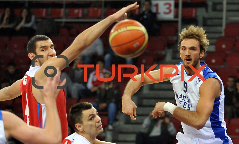 Anadolu Efes's Semih Erden (R) during their Turkish Basketball League match Anadolu Efes between Tofas at the Abdi ipekci Arena in Istanbul, Turkey on Tuesday, 24 December, 2013. Photo by TURKPIX