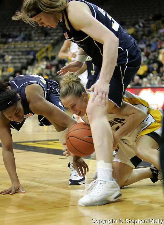 28 NOVEMBER 2007: Iowa guard Kristi Smith (11) tries to grab a lose ball on the ground in the first half of Georgia Tech's 76-57 win over Iowa in the Big Ten/ACC Challenge at Carver-Hawkeye Arena in Iowa City, Iowa on November 28, 2007.