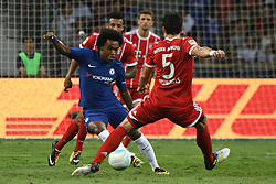Jul 25, 2017 - Singapore - Chelsea's player Willian (L) fights for the ball with Bayern Munich's player Mats Hummels (R) during the International Champions Cup match between Chelsea and Bayern Munich held in Singapore's National Stadium. (Credit Image: © Then Chih Wey/Xinhua via ZUMA Wire)