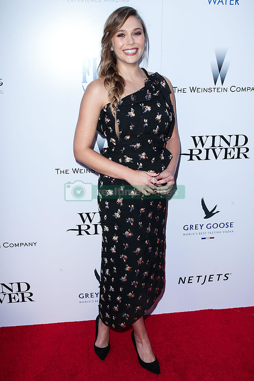 Elizabeth Olsen wearing Rodarte arrives at the premiere of The Weinstein Company's 'Wind River' at The Theatre at Ace Hotel on July 26, 2017 in Los Angeles, California. 26 Jul 2017 Pictured: Elizabeth Olsen. Photo credit: MEGA TheMegaAgency.com +1 888 505 6342