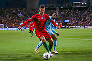 Portugal forward Cristiano Ronaldo (7) shields the ball from Netherlands Midfielder Georginio Wijnaldum (Liverpool)  during the UEFA Nations League match between Portugal and Netherlands at Estadio do Dragao, Porto, Portugal on 9 June 2019.