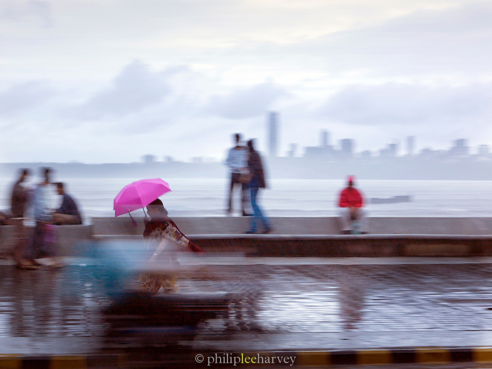 Locals on the waterfront with the Mumbai skyline in background, Mumbai, Maharashtra, India