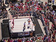 16 SEPTEMBER 2012 - PHOENIX, AZ: Lucha Libre wrestlers SUPER NOVA and CHI CHI face off in a Lucha Libre exhibition match in Phoenix, AZ, on Hispanic Heritage Day. The Arizona Diamondbacks hosted their 14th Annual Hispanic Heritage Day, Sunday to kick off Hispanic Heritage Month (Sept. 15-Oct. 15) before the 1:10 p.m. game between the D-backs and San Francisco Giants. The main attraction of the Day was three Lucha Libre USA exhibition wrestling matches in front of Chase Field stadium before the game.  PHOTO BY JACK KURTZ
