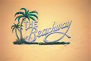 A one-of-a-kind Tropical Deco nameplate on The Beachway Apartments, designed in 1940 by architect L. Murray Dixon in Miami Beach's historic South Beach neighborhood. <br /> <br /> This photograph is from the early 1990s. Since then, this vintage sign was somehow removed and apparently lost, even though the building is in a supposedly protected historic preservation district. <br /> <br /> City preservation officials say they lack the manpower to prevent the loss of architectural details like this, even though they contribute mightily to the neighborhood's authenticity and charm.