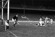 02/04/1967<br /> 04/02/1967<br /> 2 April 1967<br /> National Hurling League Semi-Final: Antrim v Kerry at Croke Park, Dublin.<br /> J. Barry, Kerry forward, is pinned to the ground by Antrim back, E. Gallagher. Barry gets a shot at the goal anyway; however it was saved by the Antrim goalie, J. Corr.