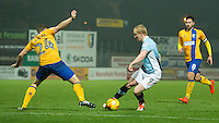 Mark Cullen of Blackpool goes past Jamie McGuire of Mansfield Town<br /> <br /> Photographer James Williamson/CameraSport<br /> <br /> The EFL Sky Bet League Two - Mansfield Town v Blackpool - Tuesday 22nd November 2016 - One Call Stadium - Mansfield<br /> <br /> World Copyright © 2016 CameraSport. All rights reserved. 43 Linden Ave. Countesthorpe. Leicester. England. LE8 5PG - Tel: +44 (0) 116 277 4147 - admin@camerasport.com - www.camerasport.com