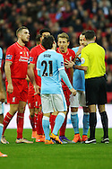 players surround Referee Michael Oliver. Capital One Cup Final, Liverpool v Manchester City at Wembley stadium in London, England on Sunday 28th Feb 2016. pic by Chris Stading, Andrew Orchard sports photography.