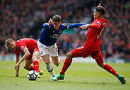 Ross Barkley of Everton in action with Roberto Firmino of Liverpool during the English Premier League match at Anfield Stadium, Liverpool. Picture date: April 1st 2017. Pic credit should read: Simon Bellis/Sportimage