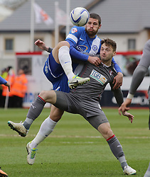 Peterborough United's Michael Bostwick in action with Rotherham United's Lee Frecklington - Photo mandatory by-line: Joe Dent/JMP - Mobile: 07966 386802 22/03/2014 - SPORT - FOOTBALL - Peterborough - London Road Stadium - Peterborough United v Rotherham United - Sky Bet League One