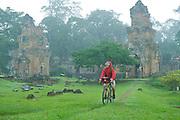 Rain Touring Cyclist - Angkor Wat - Cambodia