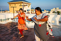 Chennai, India | 2015<br /> Hema Ramaswamy practices Bharatanatyam, a South Indian classical dance form, with her aunt, who is a dance instructor. A few months earlier, Hema had given a public dance recital, called an arangetram, to a large audience in New Jersey. Preparing for an arangetram requires years of formal training and often serves as a rite of passage for young South Indian women. Born in New Jersey to a family with roots in Chennai, Hema is believed to be the first Indian American woman with Down syndrome to complete an arangetram.